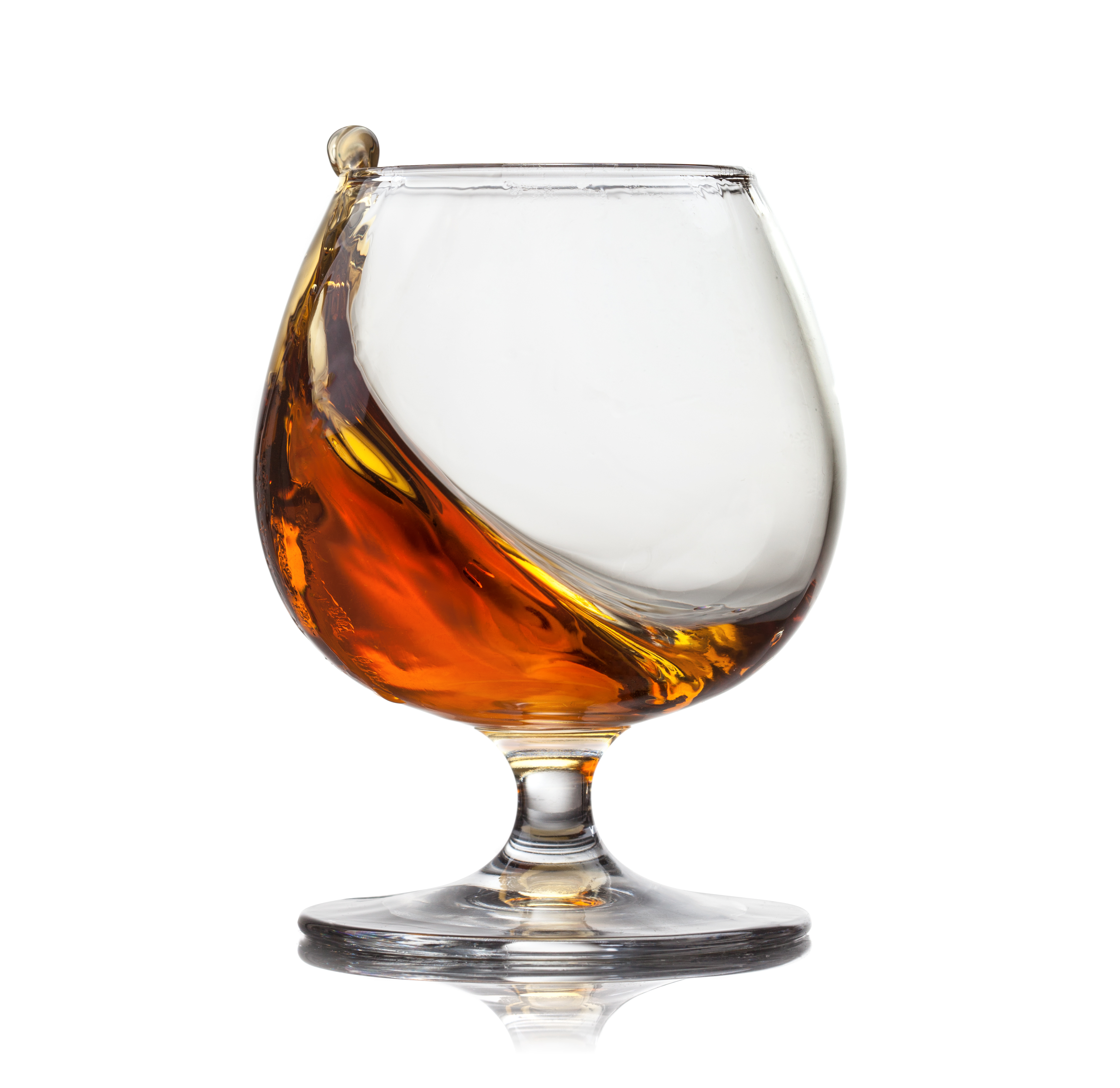 Splash,Of,Cognac,In,Glass,Isolated,On,White,Background