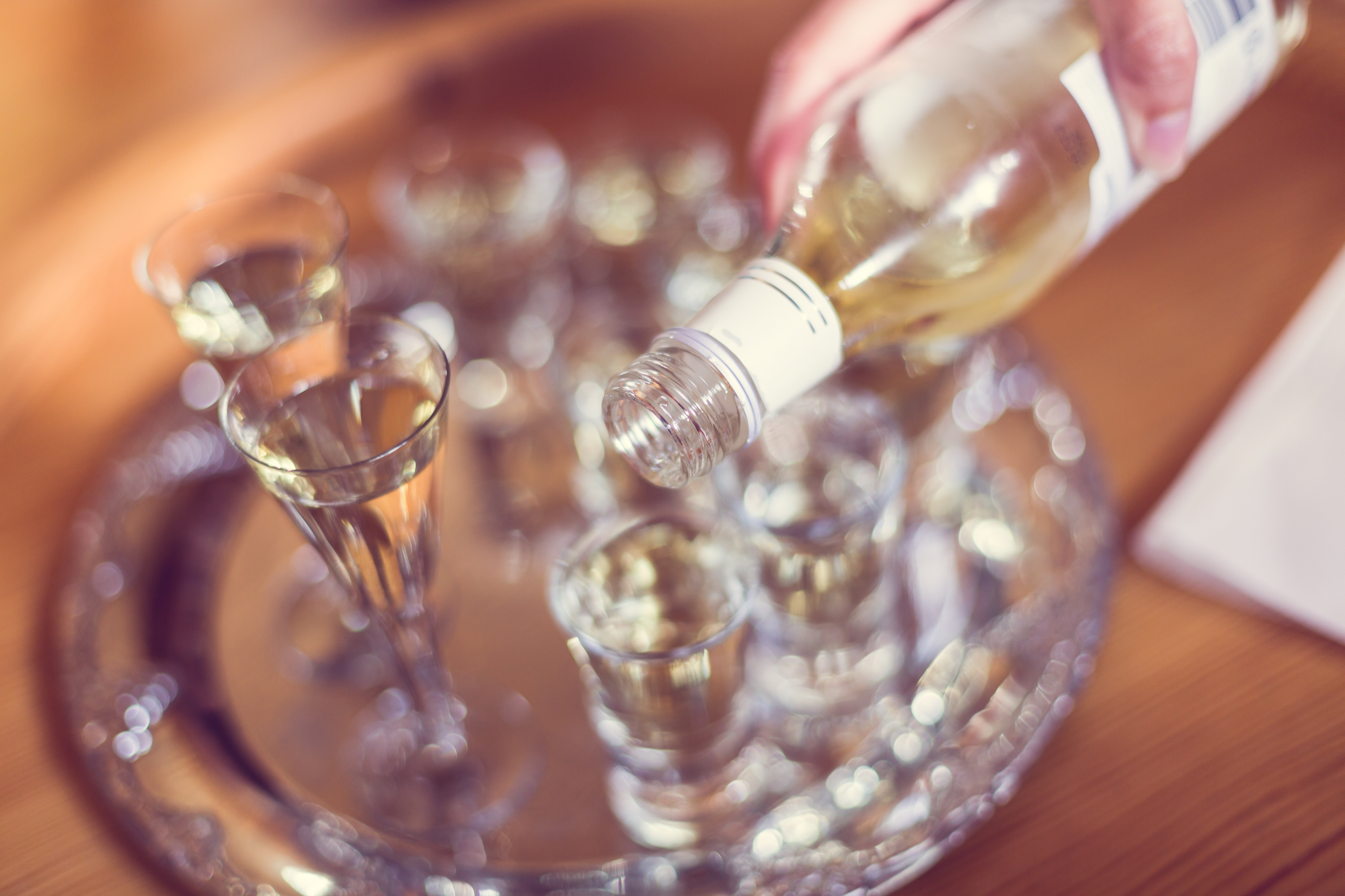 Closeup,Of,Hand,Of,Person,Pouring,Snaps,(schnaps,Alcohol),Into