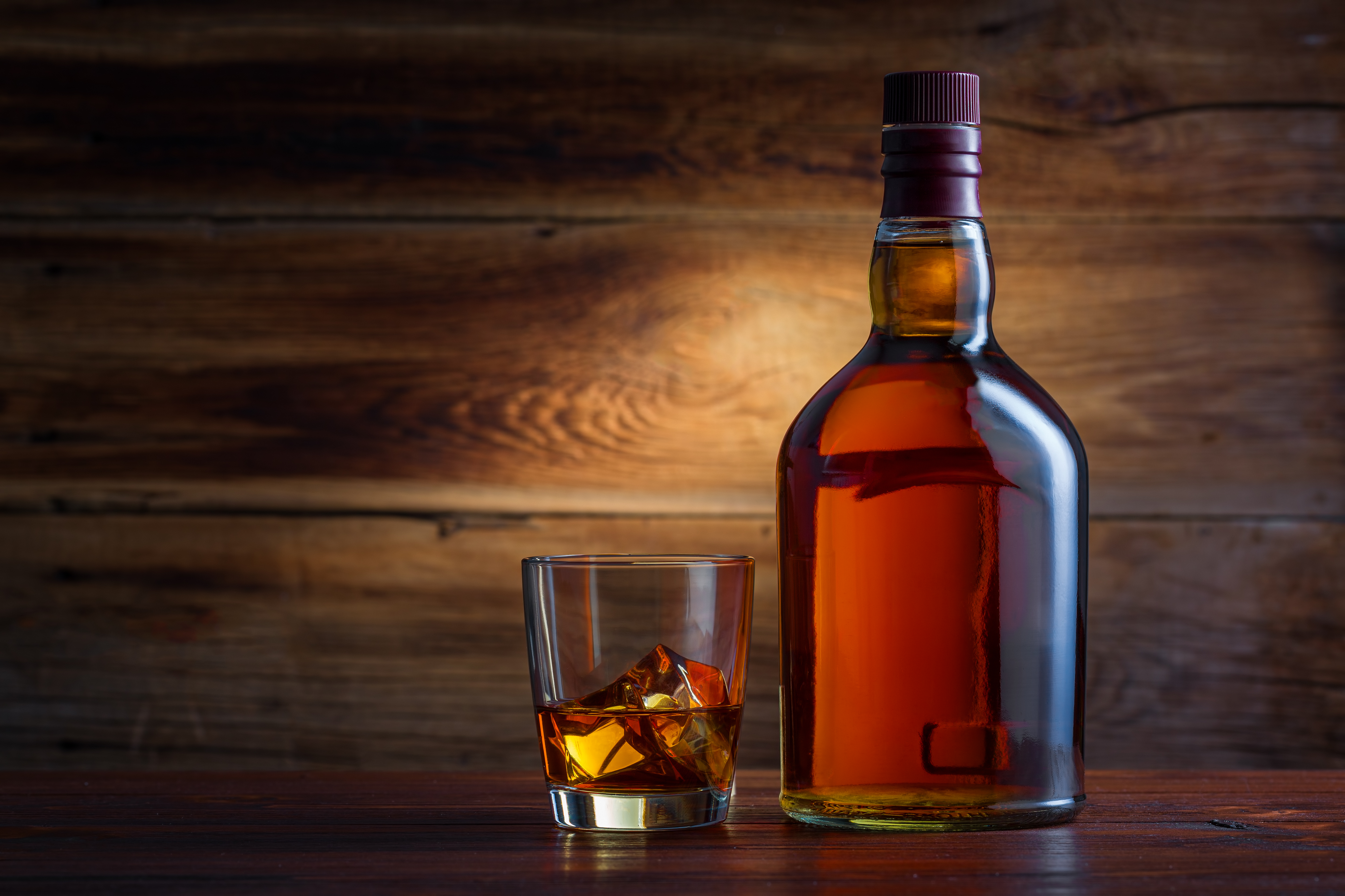 Bottle,Of,Whiskey,On,A,Wooden,Background