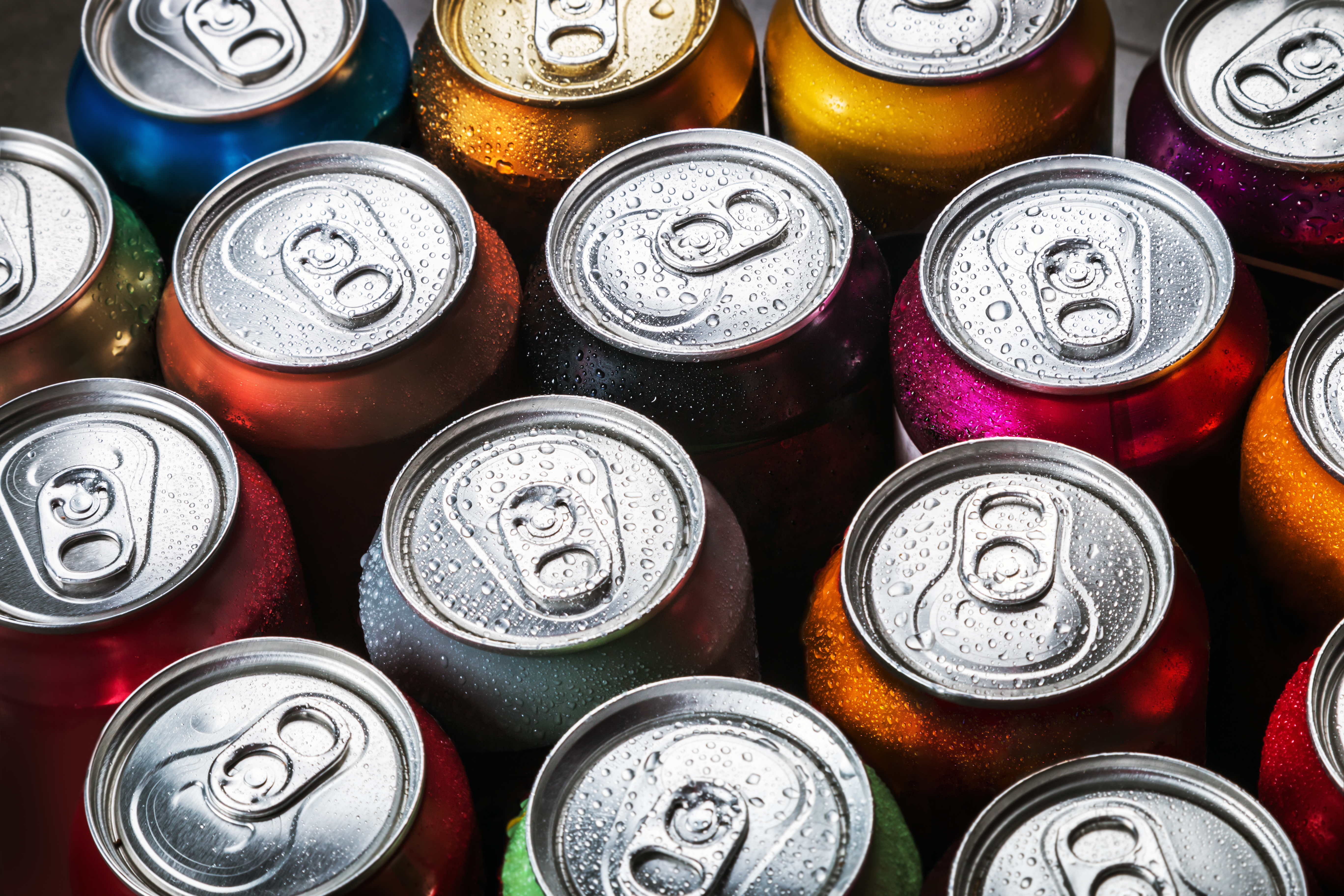 Aluminum,Cans,Of,Soda,Background.,The,View,From,The,Top