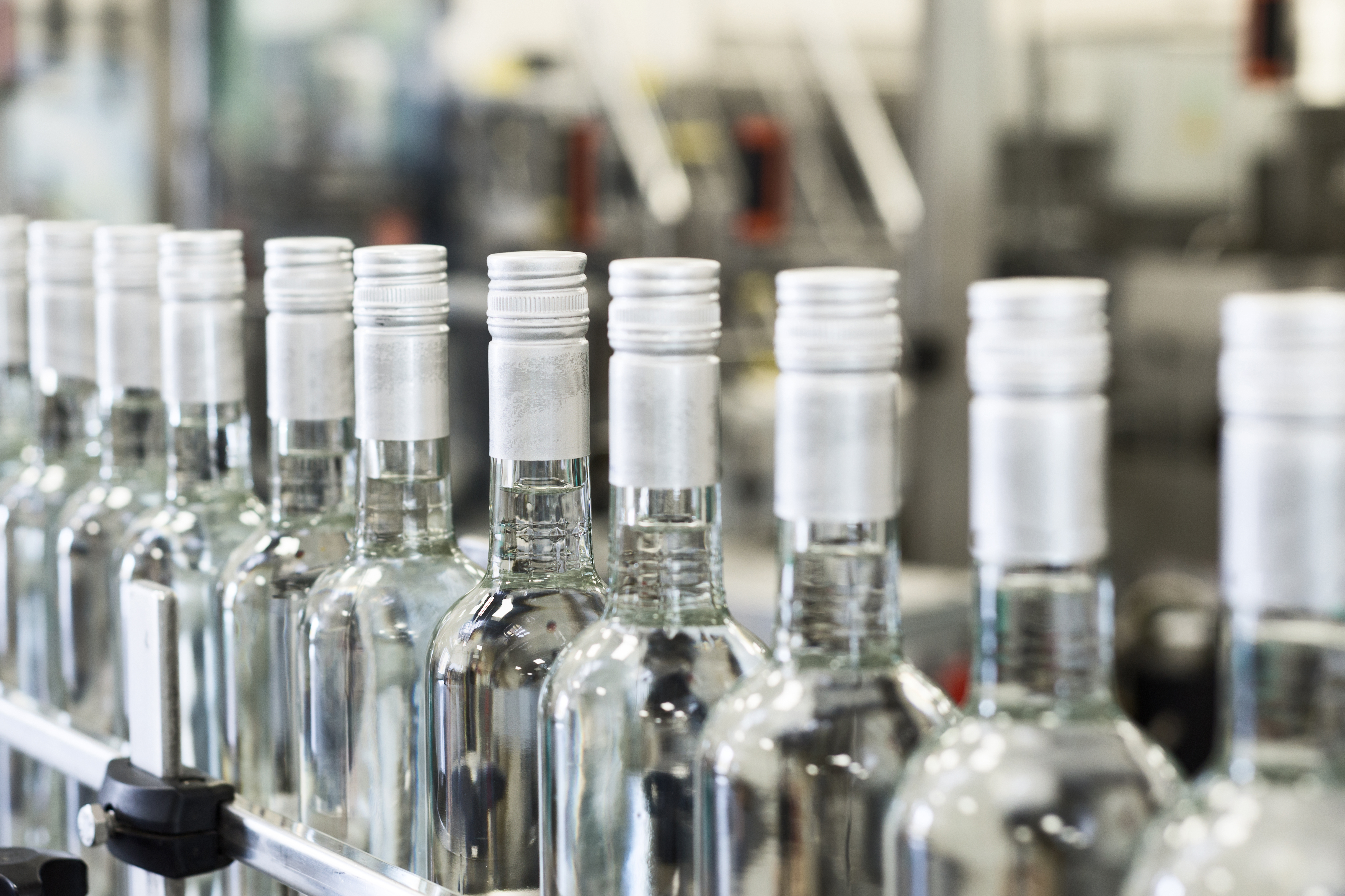 A,Long,Row,Of,Glass,Bottles,On,The,Conveyor.,Manufacture